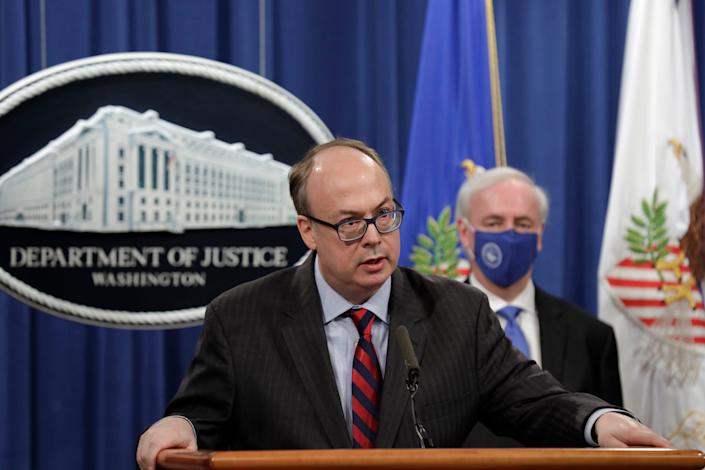 Acting Assistant U.S. Attorney General Jeffrey Clark speaks as he stands next to Deputy Attorney General Jeffrey A. Rosen during a news conference to announce the results of the global resolution of criminal and civil investigations with an opioid manufacturer at the Justice Department in Washington, Wednesday, Oct. 21, 2020.