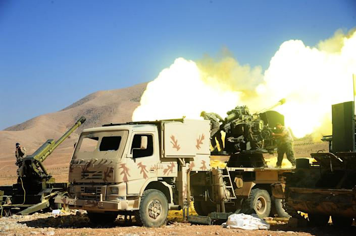 Lebanese Hezbollah fighters fire at a position of the Islamic State group in Syria's Qalamoun region in 2017. (Photo: Ammar Safarjalani/Xinhua via Zuma Wire)