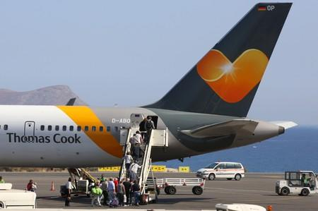 Passengers board a Thomas Cook airplane at the Heraklion airport on the island of Crete