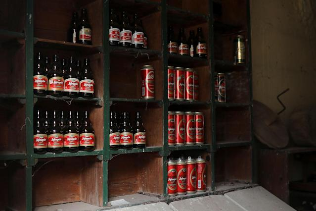 <p>Empty beer cans and bottles sit on shelves inside an abandoned shop in the village of Papratna, near the southeastern town of Knjazevac, Serbia, Aug. 14, 2017. (Photo: Marko Djurica/Reuters) </p>
