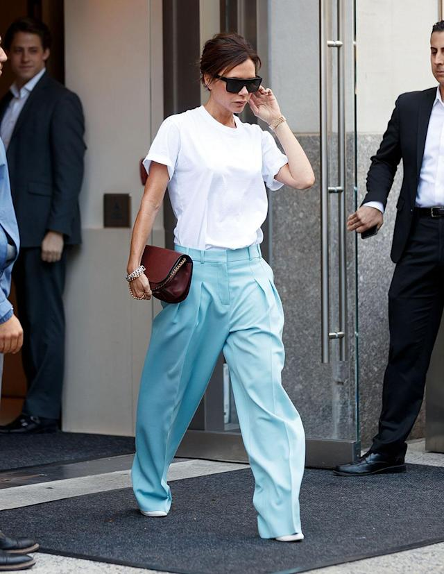 NEW YORK, NY – AUGUST 29: Victoria Beckham out and about in a white shirt and baby blue trousers in New York. (Photo by Jackson Lee/WireImage)