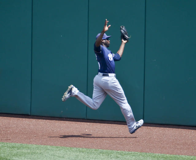 Milwaukee Brewers center fielder Lorenzo Cain makes a catch against the Pittsburgh Pirates during a baseball game, Sunday, July 15, 2018, in Pittsburgh. (AP Photo/Keith Srakocic)