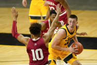 Iowa guard Joe Wieskamp, right, drives around Indiana guard Rob Phinisee (10) during the first half of an NCAA college basketball game, Thursday, Jan. 21, 2021, in Iowa City, Iowa. (AP Photo/Charlie Neibergall)