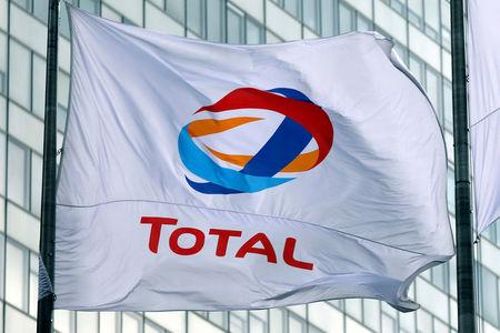 FILE PHOTO: A flag bearing the logo of French oil giant Total