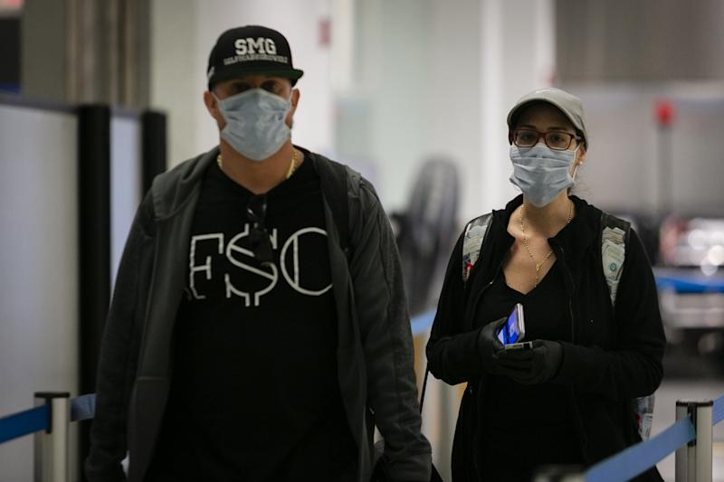 FLORIDA, USA - MARCH 29: Passengers are seen wearing protective masks and gloves at Miami International Airport in Miami, Florida, United States on March 29, 2020. (Photo by Eva Marie Uzcategui Trinkl/Anadolu Agency via Getty Images)
