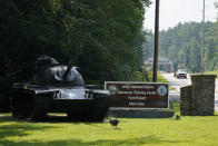 Traffic moves toward a tank and sign at the main entrance to Fort Pickett Wednesday, Aug. 25, 2021, in Blackstone, Va. Afghan refugees who have been prescreened by the U.S. Department of Homeland Security have been taken to Fort Lee as well as Fort Pickett according to Virginia Gov. Ralph Northam. (AP Photo/Steve Helber)