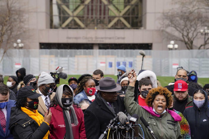 Naisha Wright, aunt of Daunte Wright, right, yells the name of her deceased nephew during a news conference outside the Hennepin County Government Center, Tuesday, April 13, 2021, in Minneapolis. Daunte Wright, 20, was shot and killed by police Sunday after a traffic stop in Brooklyn Center, Minn. (AP Photo/John Minchillo)