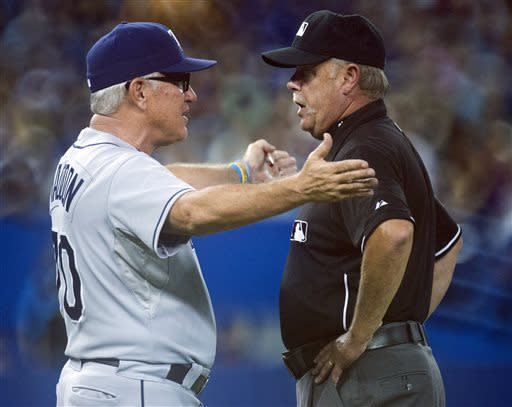 Tampa Bay Rays manager Joe Maddon has words with second base umpire Jim Joyce during the second inning of a baseball game against the Toronto Blue Jays in Toronto on Friday, July 19, 2013. (AP Photo/The Canadian Press, Frank Gunn)