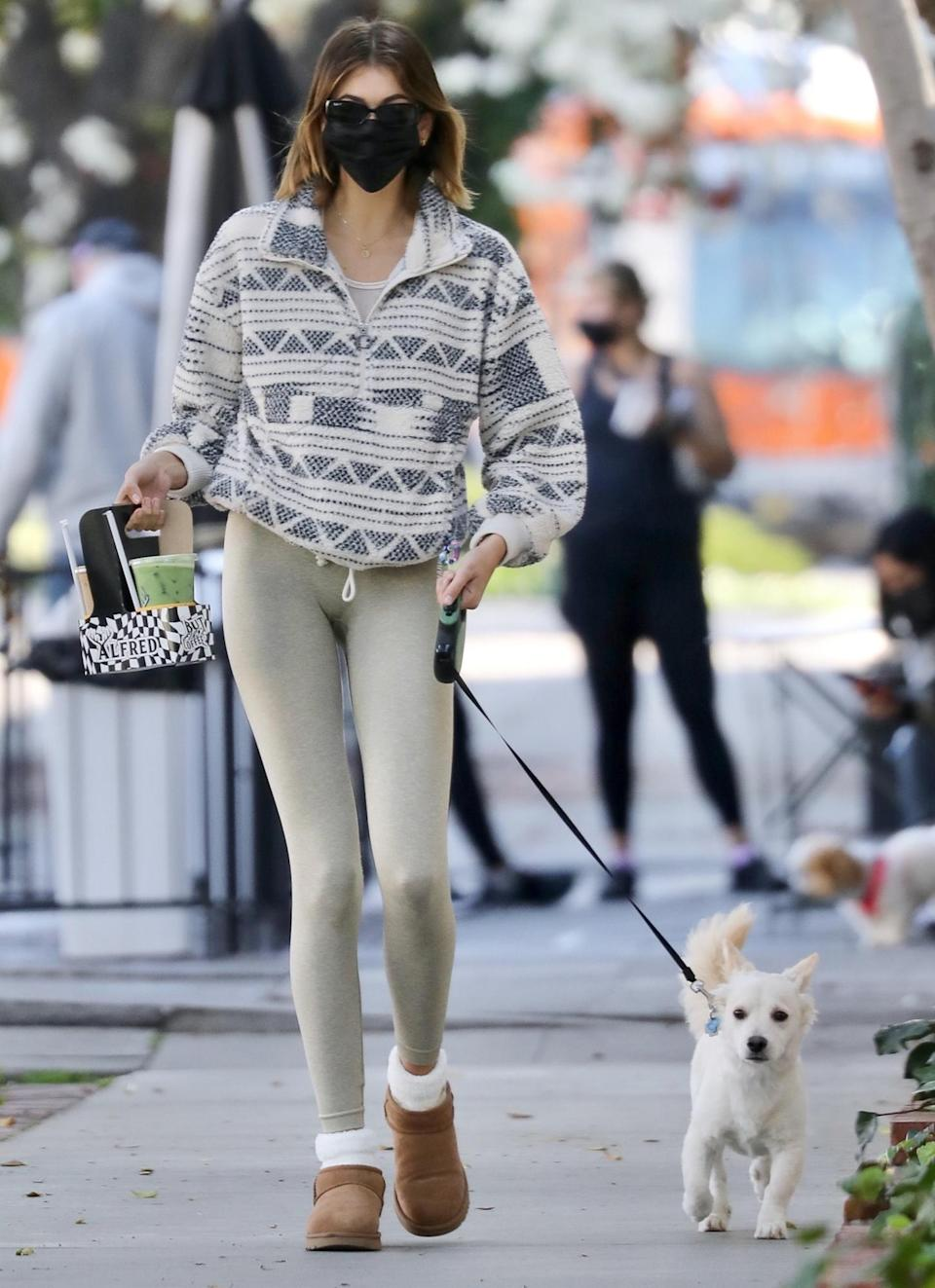 <p>Kaia Gerber steps out for morning coffee at Alfred Coffee with pup Milo on Tuesday in West Hollywood.</p>
