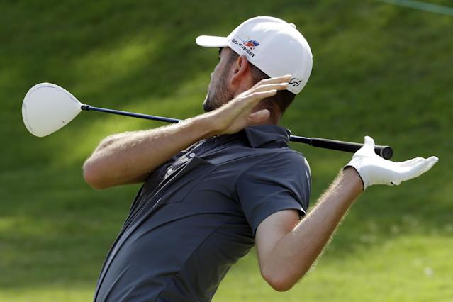 Troy Merritt lets go of his driver as he tees off on the first hole during the third round of the St. Jude Classic golf tournament Saturday, June 7, 2014, in Memphis, Tenn. (AP Photo/Mark Humphrey)