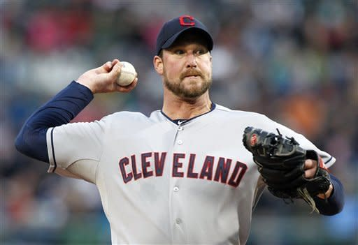 Cleveland Indians' Derek Lowe pitches in the first inning of a baseball game against the Boston Red Sox in Boston, Thursday, May 10, 2012. (AP Photo/Michael Dwyer