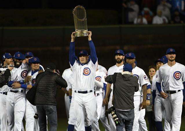 Anthony Rizzo hoists the Cubs' World Series trophy. (AP)