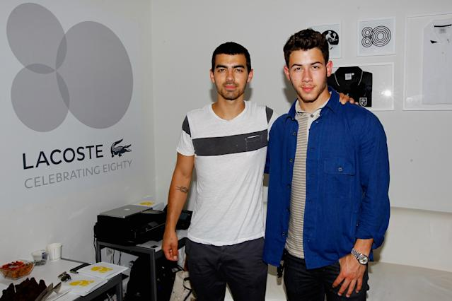 NEW YORK, NY - SEPTEMBER 03: (L-R) Musicians Joe Jonas and Nick Jonas of of The Jonas Brothers attend Day Nine of the 2013 US Open at the USTA Billie Jean King National Tennis Center on September 3, 2013 in New York City. (Photo by Jaime L. Mikle/Getty Images for the USTA)