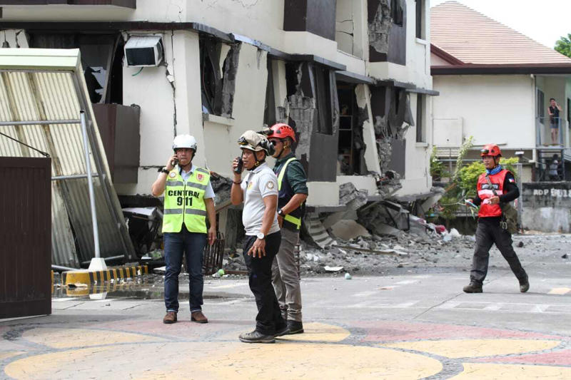 Rescue workers assess the damage in a residential condominium building that partially collapsed after a strong earthquake in Davao City, Philippines, Thursday, Oct. 31 2019. The third strong earthquake this month jolted the southern Philippines on Thursday morning, further damaging structures already weakened by the earlier shaking. (AP Photo)