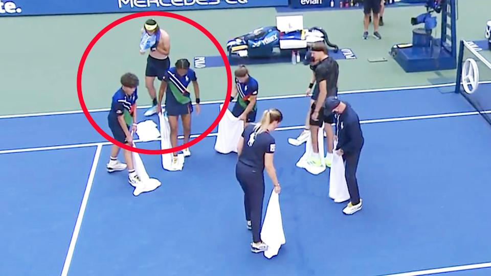 US Open ball kids, pictured here drying the court after Lloyd Harris' outburst.