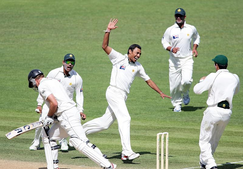 NAPIER, NEW ZEALAND - DECEMBER 12: Danish Kaneria of Pakistan celebrates the wicket of Tim McIntosh of New Zealand during day two of the Third Test match between New Zealand and Pakistan at McLean Park on December 12, 2009 in Napier, New Zealand. (Photo by Hannah Peters/Getty Images)
