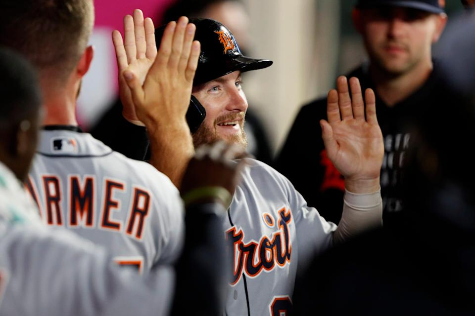 Detroit Tigers' Robbie Grossman gets congratulations from teammates after scoring against the Los Angeles Angels during the eighth inning of a baseball game in Anaheim, Calif., Thursday, June 17, 2021.