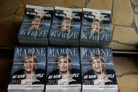 Political leaflets for Marine Le Pen, French National Front (FN) political party leader and candidate for French 2017 presidential election, are seen at her local headquarters in Henin-Beaumont, France, April 6, 2017. REUTERS/Pascal Rossignol