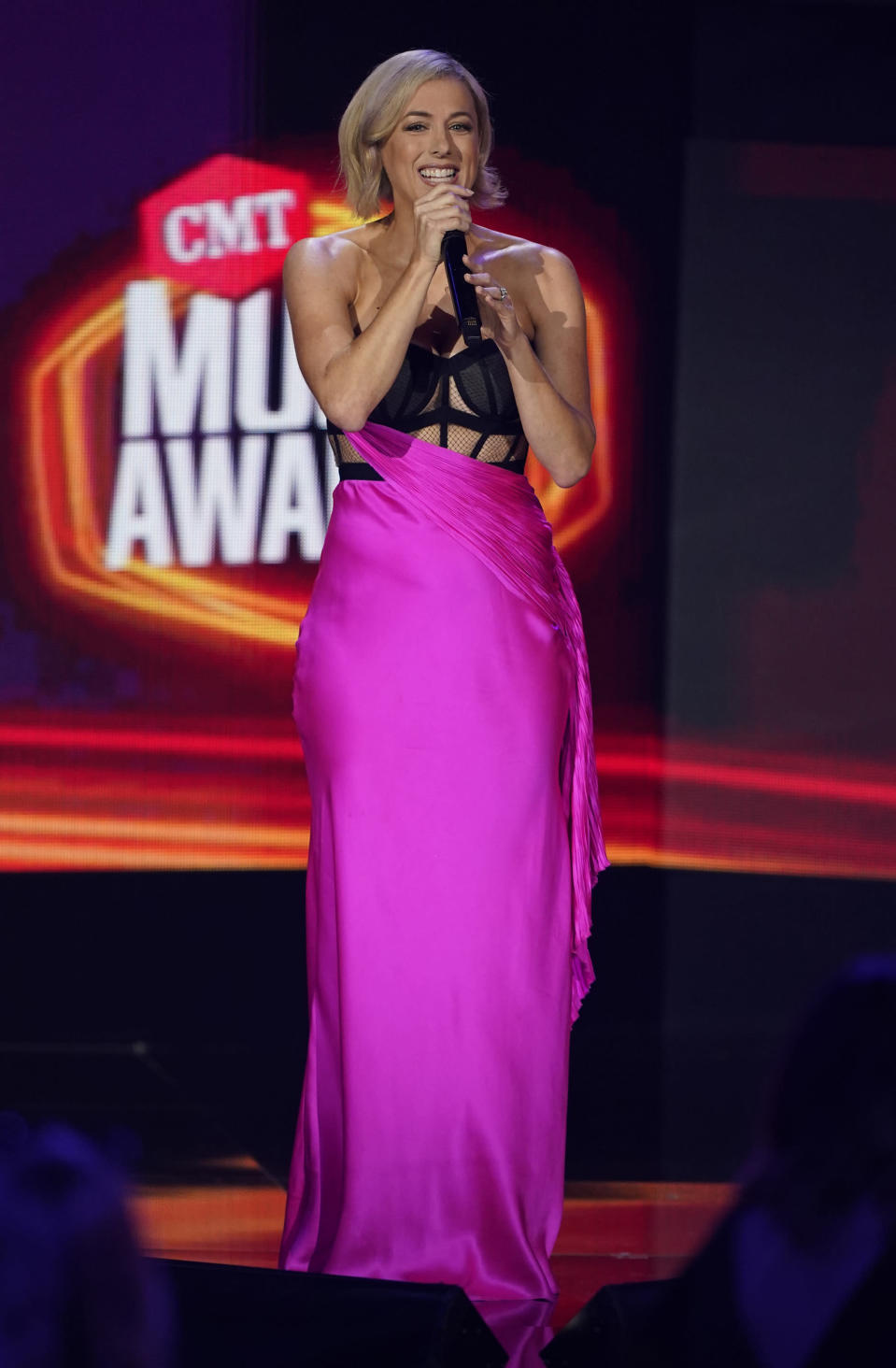 Iliza Shlesinger presents the award for collaborative video of the year at the CMT Music Awards at the Bridgestone Arena on Wednesday, June 9, 2021, in Nashville, Tenn. (AP Photo/Mark Humphrey)