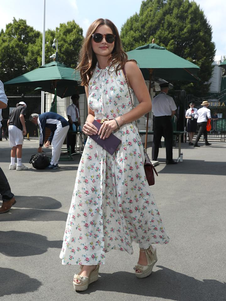 <p>Jenna Coleman dressed for the British heatwave in the Norika dress from the Matches x Emilia Wickstead collection teamed with summer-ready wedges on 13 July. <em>[Photo: PA]</em> </p>