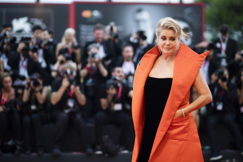 "FILE - In this Aug. 28, 2019 file photo, French actress Catherine Deneuve poses for photographers upon arrival at the premiere of the film 'The Truth' and the opening gala at the 76th edition of the Venice Film Festival, Venice, Italy. Denueve's family said in a statement released Wednesday Nov. 6, 2019, that the 76-year-old actress suffered a ""very limited and therefore reversible"" stroke. (Photo by Arthur Mola/Invision/AP, File)"