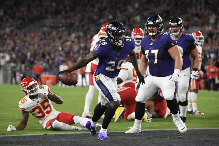 Baltimore Ravens running back Latavius Murray (28) celebrates after scoring a touchdown in the first half of an NFL football game against the Kansas City Chiefs, Sunday, Sept. 19, 2021, in Baltimore. (AP Photo/Julio Cortez)