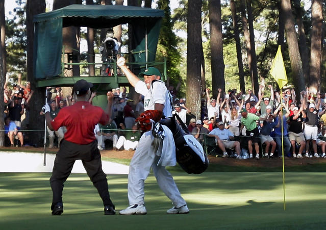FILE - In this April 10, 2005, file photo, Tiger Woods celebrates with his caddie Steve Williams after his chip-in birdie on the 16th hole during the 2005 Masters at Augusta National Golf Club in Augusta, Ga. Jordan Spieth was so inspired by this major and that moment that it was the first shot he wanted to try when he played the Masters for the first time. (AP Photo/Elise Amendola, File)