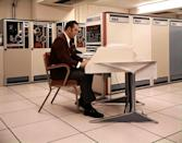<p>Computers were becoming more prevalent, but the technology of the time did not allow them to be very compact - oftentimes, entire rooms were dedicated to store mainframe computing equipment. Here, a man sits at the computer work station for a mainframe data information system manufactured by Radio Corporation of America (RCA). </p>