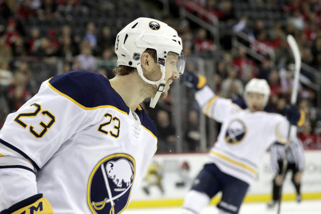 Buffalo Sabres center Sam Reinhart (23) looks on after scoring a goal on the New Jersey Devils during the first period of an NHL hockey game, Monday, March 25, 2019, in Newark, N.J. (AP Photo/Julio Cortez)