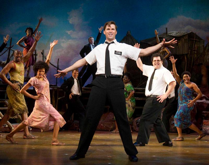 "In this theater publicity image released by Boneau/Bryan-Brown, Andrew Rannells, center, performs with an ensemble cast in ""The Book of Mormon"" at the Eugene O'Neill Theatre in New York. Ghostlight Records said Tuesday, April 26, 2011, it will release the original Broadway cast album digitally on May 24 and physically on June 7. (AP Photo/Boneau/Bryan-Brown, Joan Marcus)"