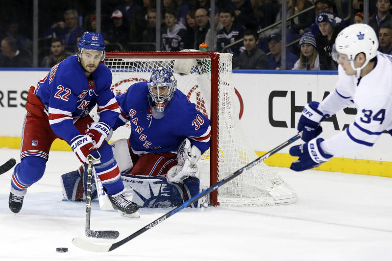 Dec 23, 2017; New York, NY, USA; New York Rangers defenseman Kevin Shattenkirk (22) clears the puck in front of Rangers goalie Henrik Lundqvist (30) from Toronto Maple Leafs center Auston Matthews (34) during the first period at Madison Square Garden. Mandatory Credit: Adam Hunger-USA TODAY Sports
