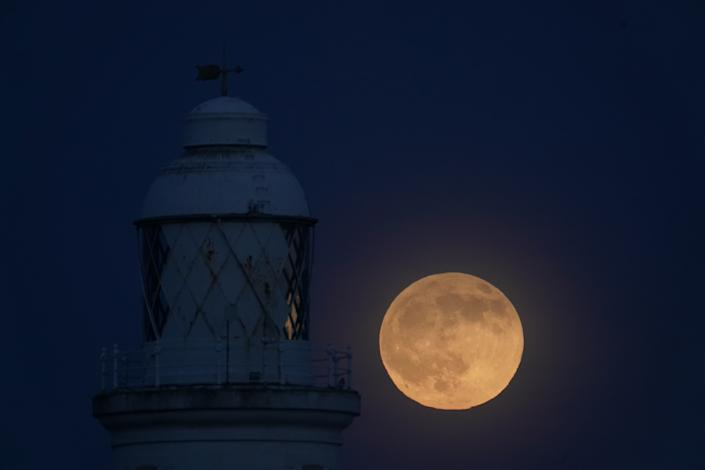 "A view of the ""wolf moon"",the first full moon of 2020, over St Mary's Lighthouse at Whitley Bay in Northumberland, on the night that it coincides with a penumbral lunar eclipse."