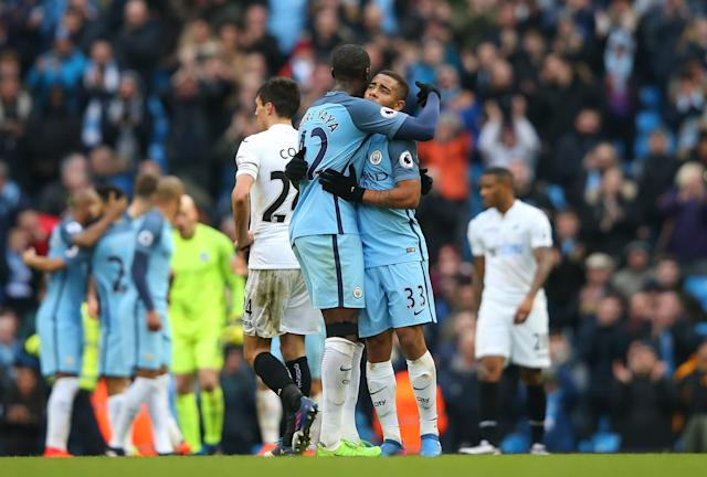 <p>Gabriel Jesus of Manchester City and Yaya Toure of Manchester City celebrate during the Premier League match between Manchester City and Swansea City at Etihad Stadium on February 5, 2017 in Manchester, England. </p>