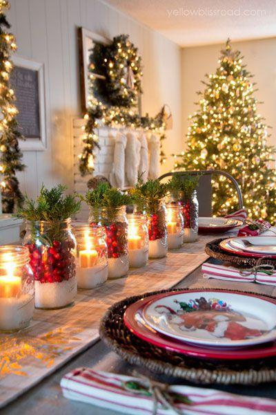 """<p>To craft the centerpieces for her dining room table, blogger <a href=""""https://www.countryliving.com/home-design/house-tours/a6389/yellow-bliss-road-christmas-house-tour/"""" rel=""""nofollow noopener"""" target=""""_blank"""" data-ylk=""""slk:Kristin Bergthold"""" class=""""link rapid-noclick-resp"""">Kristin Bergthold</a> used cranberries, juniper, and a layer of Epsom salt.</p><p><strong><a href=""""https://www.amazon.com/s?url=search-alias%3Dgarden&field-keywords=mason+jars"""" rel=""""nofollow noopener"""" target=""""_blank"""" data-ylk=""""slk:SHOP MASON JARS"""" class=""""link rapid-noclick-resp"""">SHOP MASON JARS</a></strong></p>"""