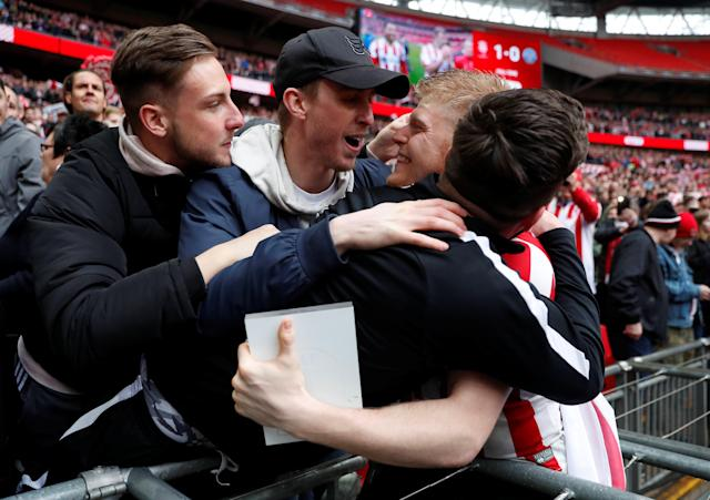 """Soccer Football - Checkatrade Trophy Final - Lincoln City vs Shrewsbury Town - Wembley Stadium, London, Britain - April 8, 2018 Lincoln City's Elliot Whitehouse celebrates with fans after winning the Checkatrade Trophy Final Action Images/Matthew Childs EDITORIAL USE ONLY. No use with unauthorized audio, video, data, fixture lists, club/league logos or """"live"""" services. Online in-match use limited to 75 images, no video emulation. No use in betting, games or single club/league/player publications. Please contact your account representative for further details."""