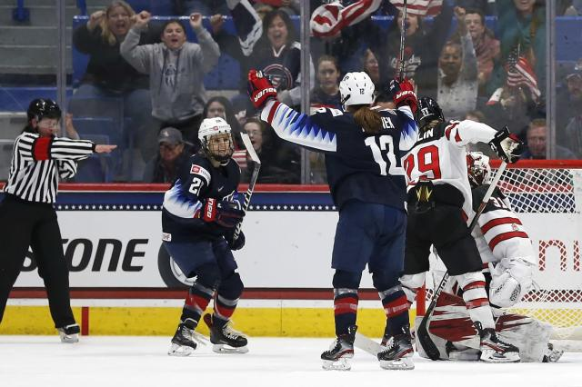 United States' Amanda Kessel (28) celebrates her goal with teammate Kelly Pannek (12) during the second period of a rivalry series women's hockey game against Canada in Hartford, Conn., Saturday, Dec. 14, 2019. (AP Photo/Michael Dwyer)