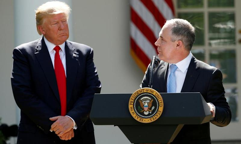 President Trump listens to EPA Administrator Pruitt after announcing decision to withdraw from Paris Climate Agreement in the White House Rose Garden in Washington.