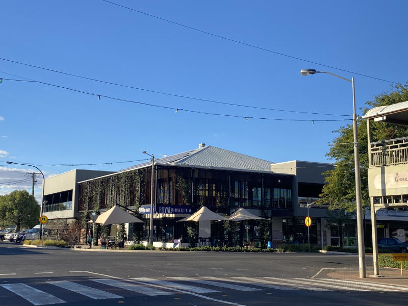 Pictured is the Royal on Ninety-Nine hotel in Roma on a sunny day.
