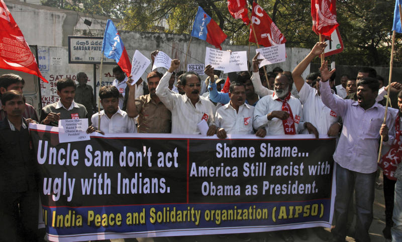 """Left party activists shout slogans during a protest against the alleged mistreatment of New York based Indian diplomat Devyani Khobragade, near the U.S Consulate in Hyderabad, India, Thursday, Dec. 19, 2013. The Indian diplomat said she faced repeated """"handcuffing, stripping and cavity searches"""" following her arrest in New York City on visa fraud charges in a case that has infuriated the government in New Delhi. (AP Photo/Mahesh Kumar A.)"""