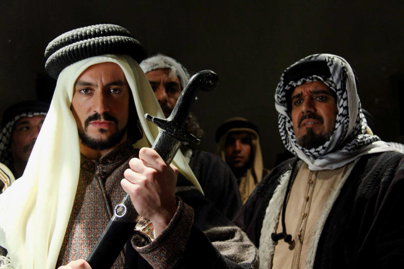 """This undated photo provided by office of Najdat Anzour shows a scene from a new movie titled """"King of the Sands"""" by leading Syrian producer Najdat Anzour. Syria is hitting back at Saudi Arabia for its support for rebels seeking to topple President Bashar Assad with an English-language movie that depicts the founder of Saudi Arabia as a bloodthirsty womanizer. The taboo-breaking film, King of the Sands, opened to much fanfare at the Damascus Opera House on Thursday, Dec. 12, 2013, despite calls from the Saudi royal family to have it banned, underlining the unprecedented downturn in relations between the two countries resulting from the Syrian conflict. (AP Photo)"""