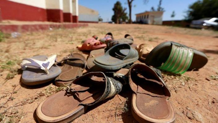 Sandals sit in the dirt following an attack on a Nigerian school