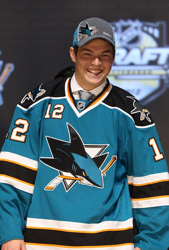 PITTSBURGH, PA - JUNE 22:  Tomas Hertl, 17th overall pick by the San Jose Sharks, poses on stage during Round One of the 2012 NHL Entry Draft at Consol Energy Center on June 22, 2012 in Pittsburgh, Pennsylvania.  (Photo by Bruce Bennett/Getty Images)