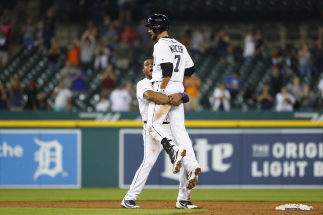 Detroit Tigers' Jordy Mercer celebrates with Jeimer Candelario (46) after his single to score Willi Castro in the ninth inning of a baseball game against the New York Yankees in Detroit, Tuesday, Sept. 10, 2019. Detroit won 12-11. (AP Photo/Paul Sancya)
