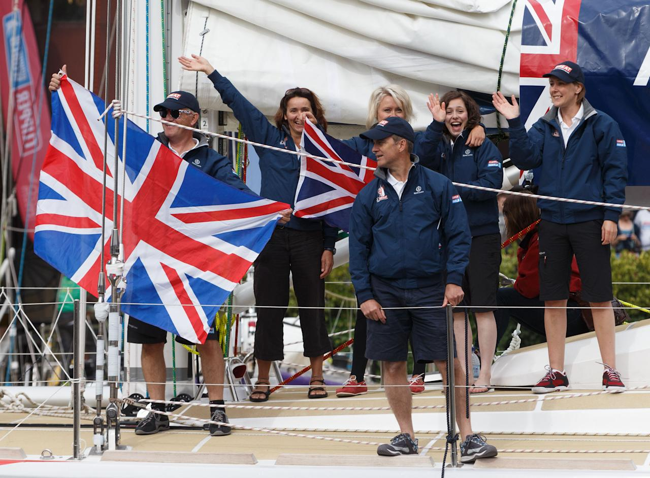 Crew members of the Great Britain yacht wave to members of the public during the start of the Clipper Round the World Race at St Katharine Docks, London.
