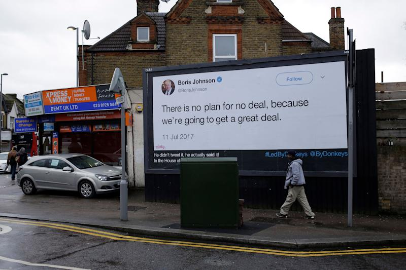 """A billboard is displayed in north London on Feb. 8, 2019, as part of the """"Led By Donkeys"""" campaign that aims to highlight misleading statements made about Brexit made by politicians."""