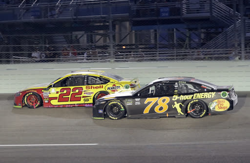 Joey Logano (22) and Martin Truex Jr. (78) drive on the track during the NASCAR Cup Series Championship auto race at the Homestead-Miami Speedway, Sunday, Nov. 18, 2018, in Homestead, Fla. (AP Photo/Lynne Sladky)