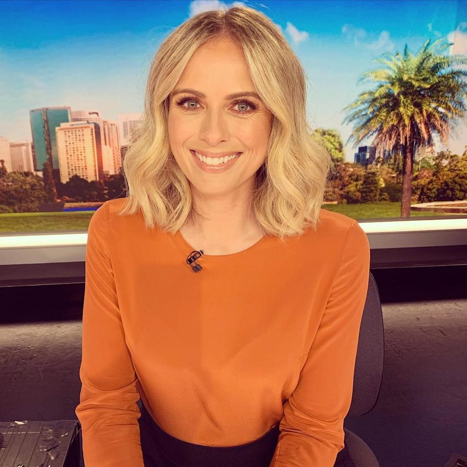Sylvia Jeffreys wearing an orange top on the set of Today Extra