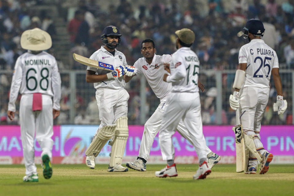Bangladesh's cricketers celebrate the dismissal of India's Rohit Sharma, second left, during the first day of the second test match between India and Bangladesh in Kolkata, India, Friday, Nov. 22, 2019. (AP Photo/Bikas Das)