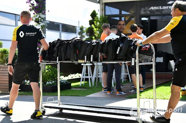 """Renault personnel wheel equipment through the paddock <span class=""""copyright"""">Mark Sutton / Motorsport Images</span>"""