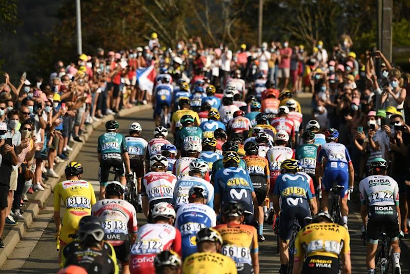 The pack rides during the 21st and last stage of the 107th edition of the Tour de France cycling race 122 km between ManteslaJolie and Champs Elysees Paris on September 20 2020 Photo by Marco Bertorello AFP Photo by MARCO BERTORELLOAFP via Getty Images